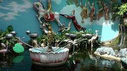 Malaysia Penang island 011 burmese buddhist temple pond with decoration carousel Footage