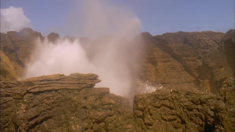 Geysers Form When Big Waves When the Water Gets to the Rocky Cliffs and Between  Footage