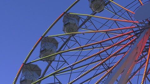 Video of ferris wheel at dusk in 4K Footage