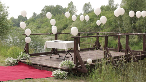 White Balloons On A River Pier Footage