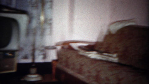 1963: Vintage style tv and living room couch and chair lifestyle furniture. BUFF Footage