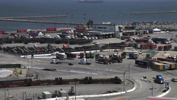 Trucks at Port of Long Beach from on top of a container crane Footage