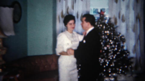 1962: Married couple celebrate Christmas with a quaint dance by the tree. BUFFAL Footage