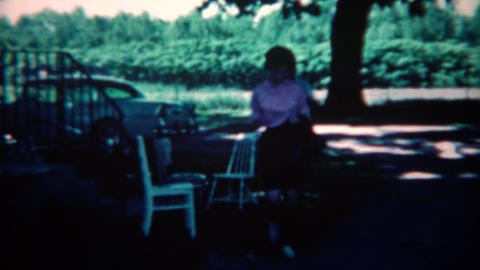 1961: Guests arriving for party with trays of food and gifts. CINCINNATI, OHIO Footage