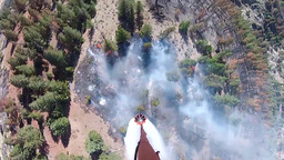 Bambi Bucket Drops from a Blackhawk Helicopter Footage