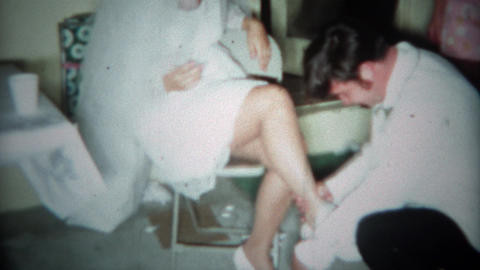 1966: Wedding garder belt removal by anxious men on sexy women legs. CINCINNATI, Footage
