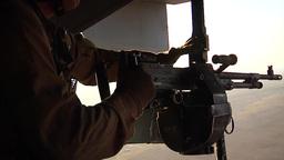 V22 Mv22 Osprey helicopter fires its door gun Footage