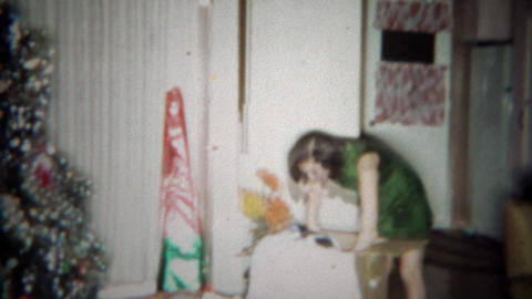 1966: Girl gets giant boxed stuffed animal toy gag gift for Christmas. BUFFALO,  Footage