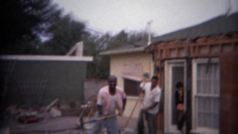 1966: Home remodeling backyard workers shovel dirt digging leveling ground. BUFF Footage