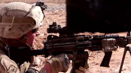 Marine fires his machine gun in support during a Firefight Footage