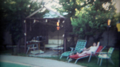 1966: Backyard grotto pool cabana lounging area at residential home. SAN DIEGO,  Footage