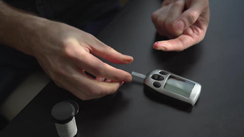 Person takes a blood sugar reading (Part B) Footage