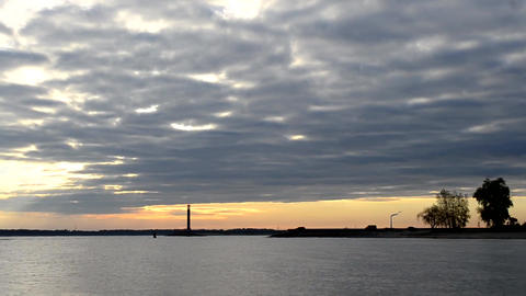 Dramatic time lapse with dark blue clouds at dawn and lighthouse Footage