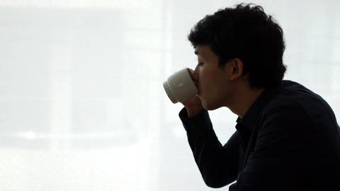 Men drinking hot drinks at a cafe (coffee / tea) Live Action