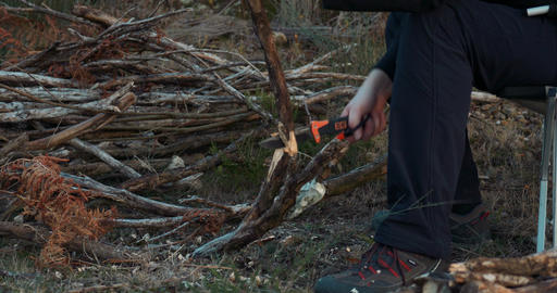 Man Batoning Branches With A Survival Knife For A Camp Fire Live Action