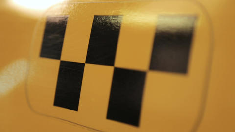 Taxi logo on the car Close-up Footage