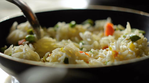 Pour white rice basmati with vegetables into a pan, home cooking, hd footage Footage