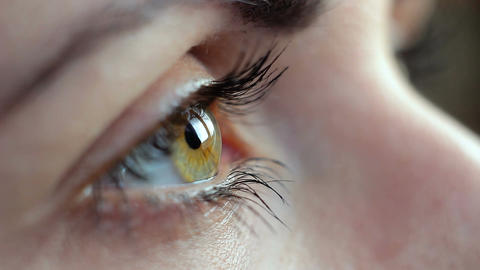 Macro filming hazel green eye, closeup, beautiful brunette eye, hd footage Footage