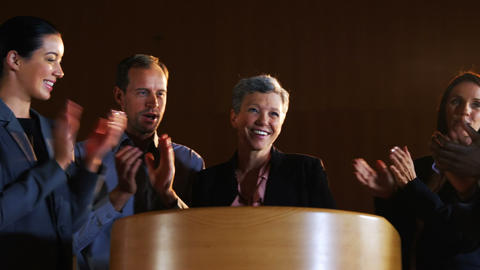Colleagues applauding speaker after conference presentation Footage
