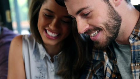 Couple using digital tablet and interacting with each other Live Action