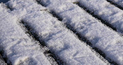 Camera slowly tilts snow pier Footage