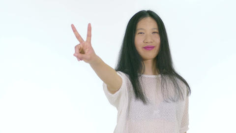 Happy Asian Chinese teenager showing peace hand sign 1 Footage