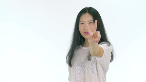 Happy Chinese teenager showing peace hand sign 1 Footage