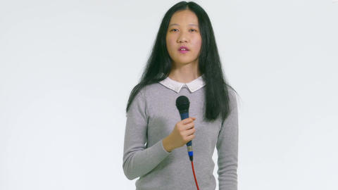 Teenage Asian girl holding mic dancing singing 1 Live影片