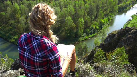 Young Woman On A Cliff Over River Footage