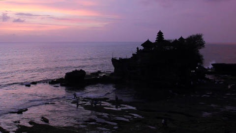sunset over hindu temple Tanah Lot, Bali, Indonesia Footage