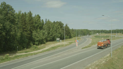 Air Plan above the Country Road with LED Lamp and Truck Footage