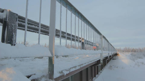 Panorama along the Snowy Bridge in Sunny Day in North Polar Footage