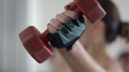 Young Woman Lifting Weights Slow Motion Footage