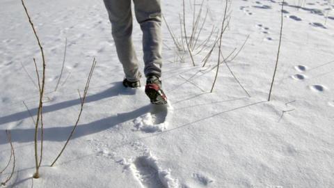 Feet Walking In Snow Slow Motion Footage