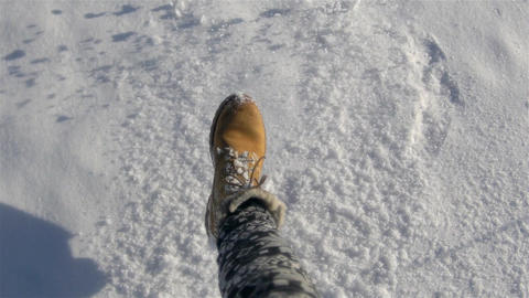 Close Up Female Legs Walking On The Snow Slow Motion Footage