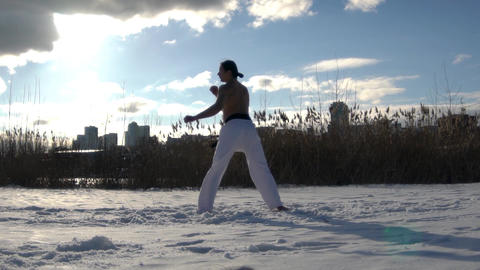 Slow Motion Taekwondo Man Trains In Park Slow Motion Live Action