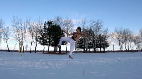Man Training Taekwondo Or Karate Man Jumping, Slow Motion GIF