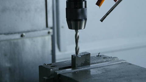 New Drill Machine Makes Hole in Workpiece against Grey Background Footage