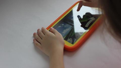 MVI 1971 child plays on tablet play Footage