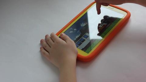 MVI 1972 child plays on tablet play Footage