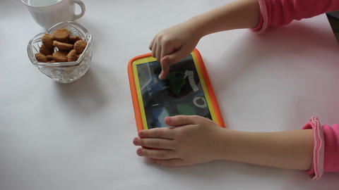 child plays on tablet play Footage