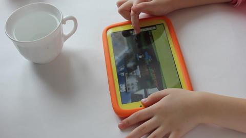 MVI 1980 child plays on tablet play Footage