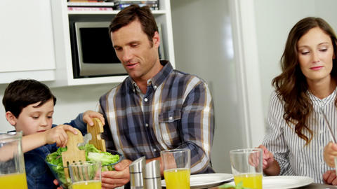 Family having healthy meal together at home Footage