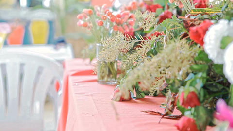 Wind Shakes Flowers and Tablecloth at Wedding Ceremony Filmmaterial