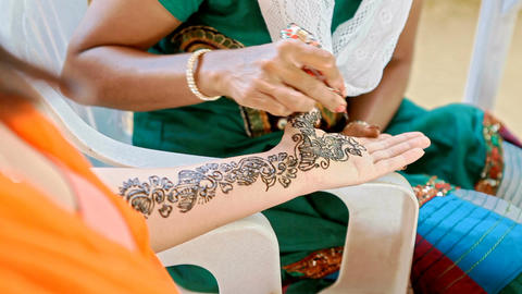 Girl Makes Traditional Painting with Henna on Bride Palm Footage
