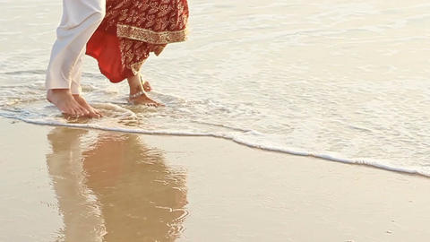 Closeup Guy Girl in Long Walk Barefoot in Shallow Water Footage