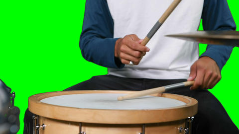 Mid section of drumer playing drum Live Action