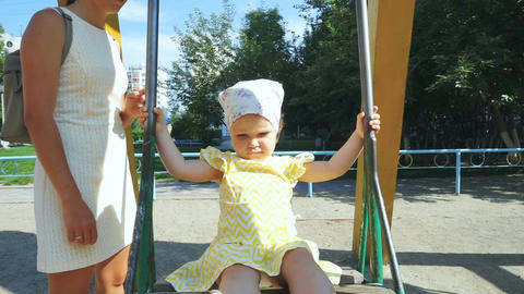 Cute little baby girl is swinging Footage