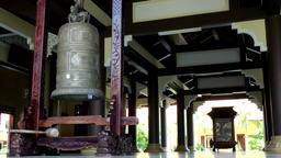 Vietnam Phú Mỹ district villages 018 giant bell in temple hall Footage