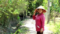 Vietnam Phú Mỹ district villages 050 vietnamese woman poses for camera Footage